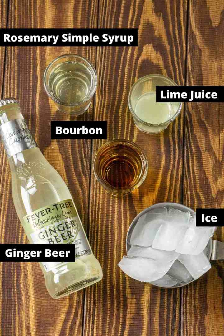 The ingredients on a wooden board with black and white labels.