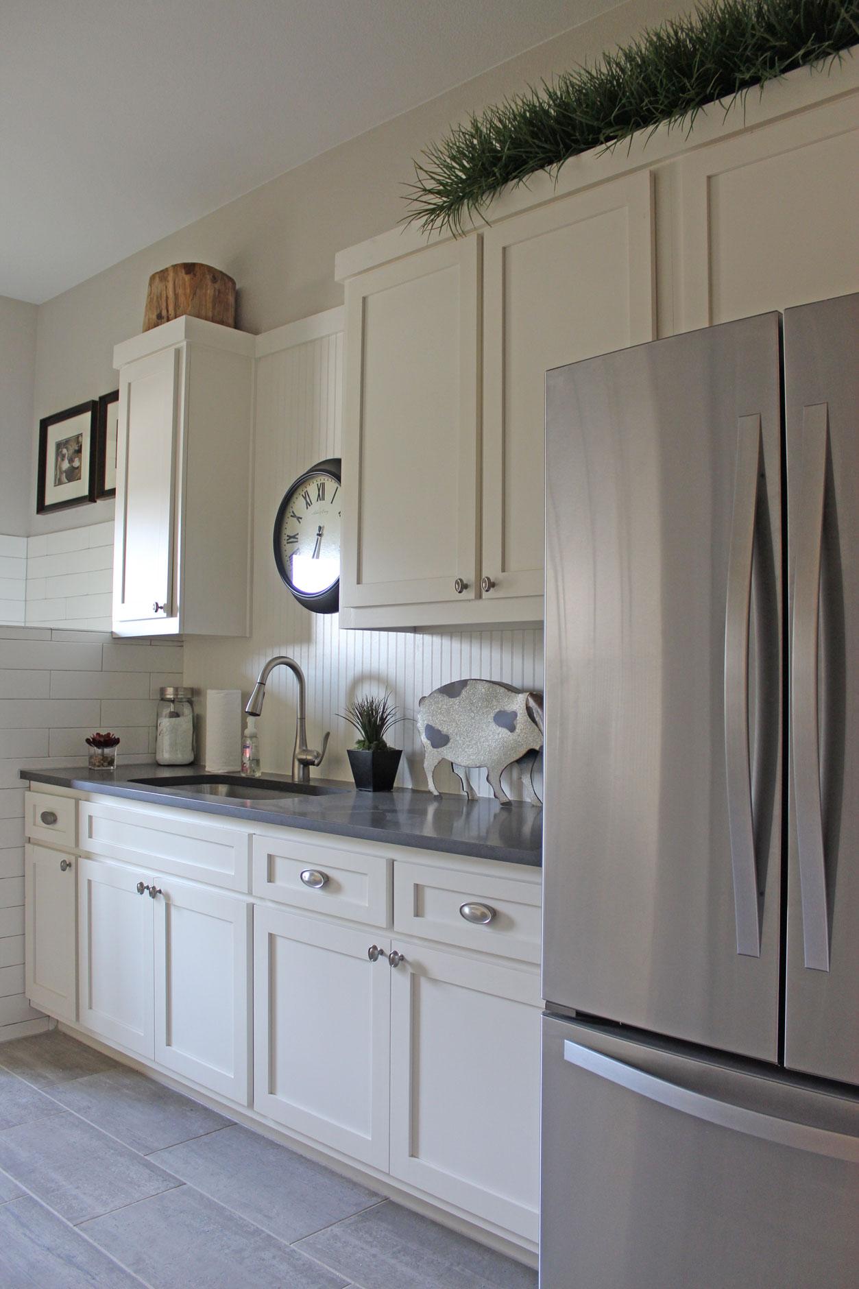 Laundry Room With White Beadboard Backsplash