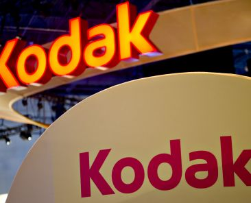 An Eastman Kodak Co. logo hangs above the company's booth at the 2012 International Consumer Electronics Show (CES) in Las Vegas, Nevada, U.S., on Thursday, Jan. 12, 2012. The 2012 CES trade show features 2,700 global technology companies presenting consumer tech products and is expected to draw over 140,000 attendees. Photographer: Daniel Acker/Bloomberg via Getty Images