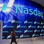 A visitor walks through the new lobby at the Nasdaq stock exchange in Times Square in New York, NY, Friday, December 19, 2014. Photograph: Victor J. Blue