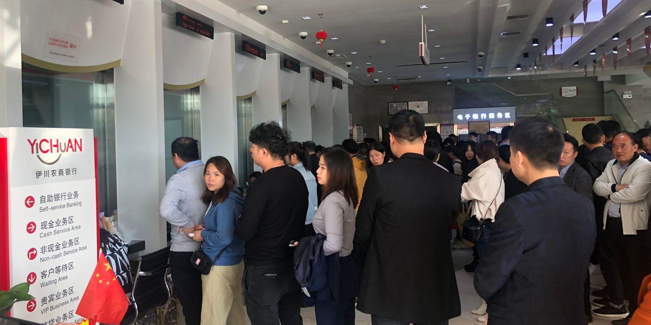 En este momento estás viendo BankRun en China Rural pone a prueba la fe en el sistema actual de miles