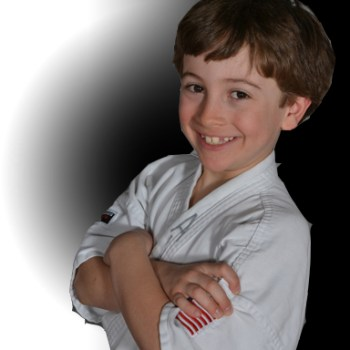 boy in karate uniform and smiling