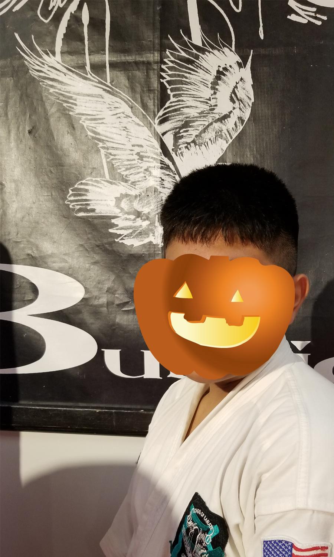 karate teen hidden by pumpkin