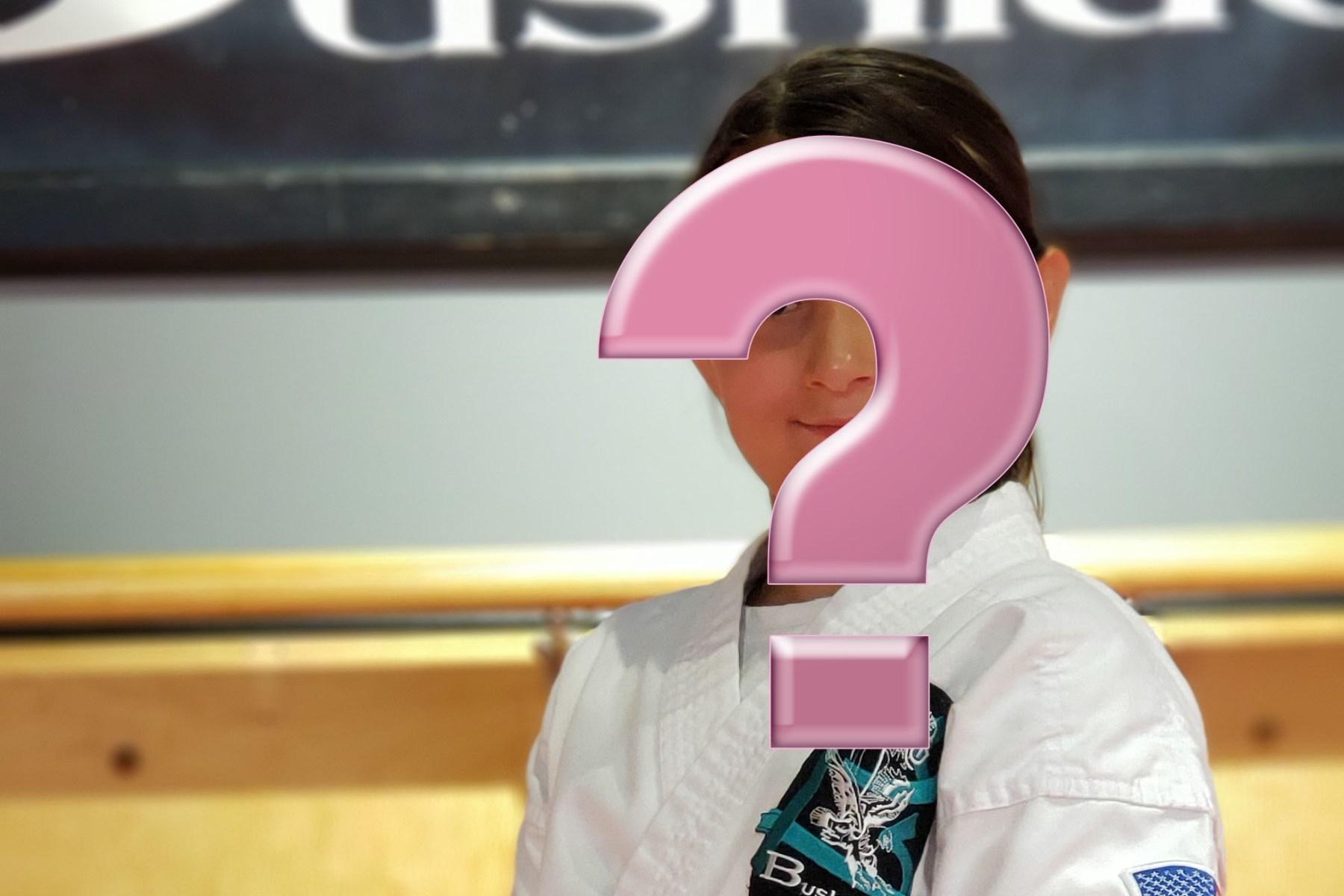 karate girl hidden by question mark