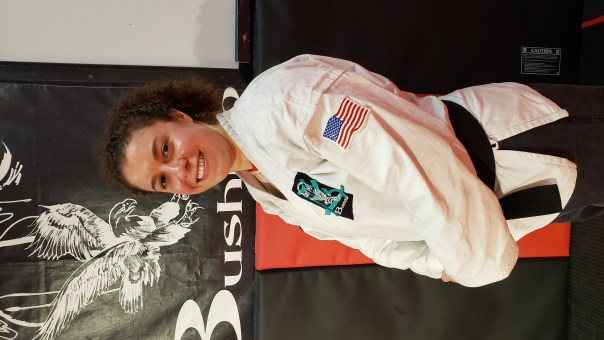 Adult female karate student in uniform