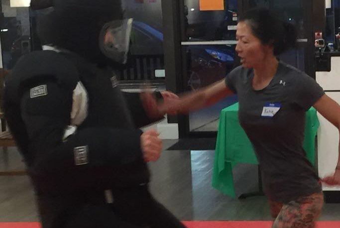 woman hitting attacker in self defense class