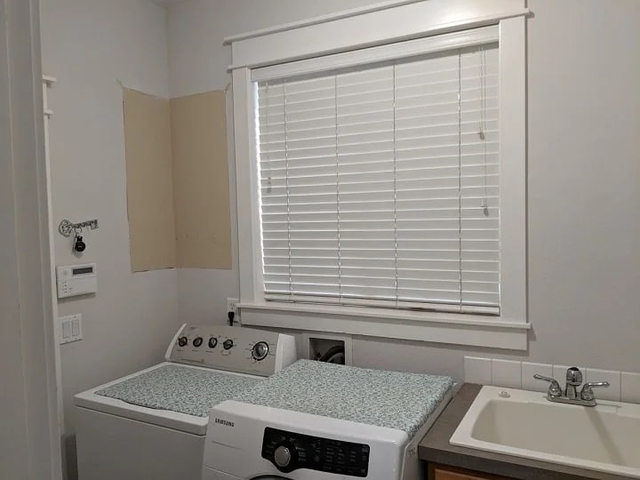 laundry room cabinet being removed