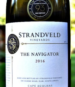 Strandveld The Navigator 2016 from cool climate Elim in South Africa. Wonderful Rhone style red, like a cross between a Cote Rotie and a Cairanne. Complex, black fruit, rich and elegant. 93 points Tim Atkin MW South Africa Report and Platters 4.5 stars. Great price at Bush Vines