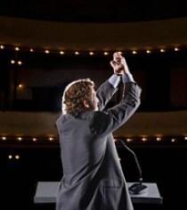 Leadership_Businessman in Auditorium_Feature