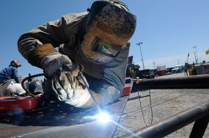A welder fabricates a portion of the BP subsea oil recovery system chamber at Wild Well Control, Inc. in Port Fourchon, La., April 26, 2010. Photo by PO3 Patrick Kelley, via Wikimedia Commons