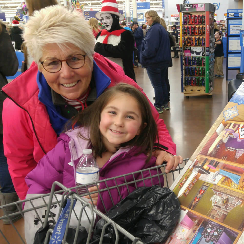 Christmas 4 Kids Pam Ogden and young girl at Walmart