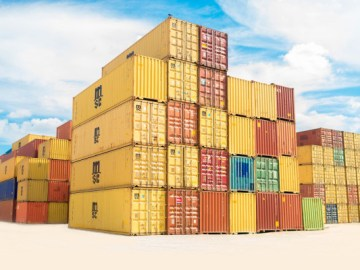 negative space colorful shipping containers frank mckenna - Drip Capital helps exporters gain access to working capital