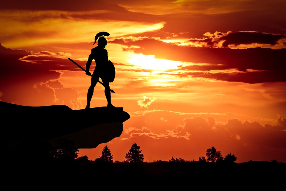 Picture of Spartan soldier silhouetted against sunrise symbolising vision and action achieving goals