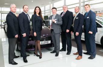 Mark Powell, Head of Business at Lloyd BMW Blackpool, pictured with the BMW Retailer of the Year award, alongside staff