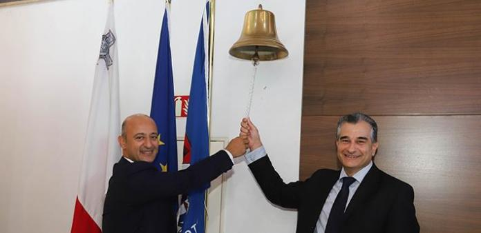 From the left: Chief Business Development Officer Kenneth Farrugia and Chief Officer Investment Services Romeo Cutajar ring the bell that commences trading. (source: Bank of Valletta media)