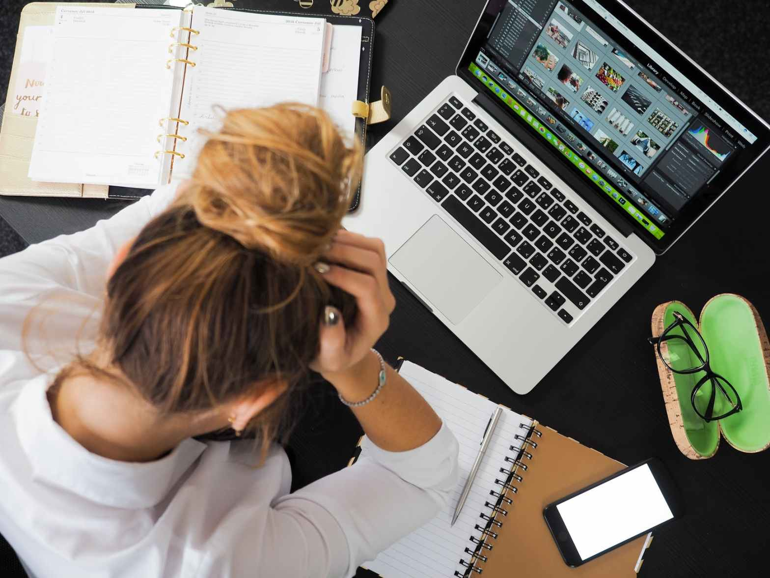 worried sales executive with laptop. Image for post sales myth you should avoid
