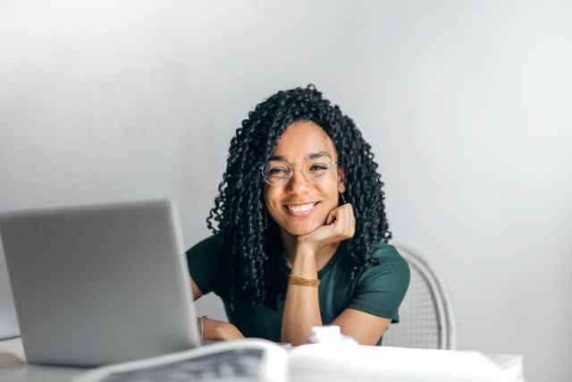 woman with laptop planning small business marketing strategy in 2020