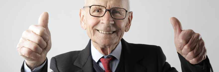 Image for Skills for Effective Management - positive senior man in eyeglasses showing thumbs up and looking at camera