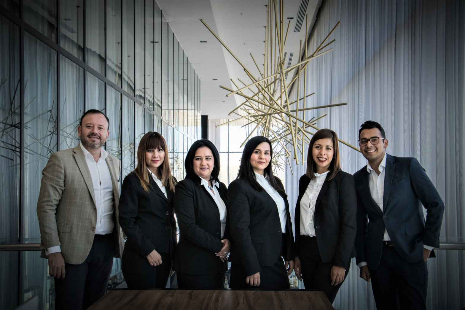 group of people in dress suits as cover images for succession planning post