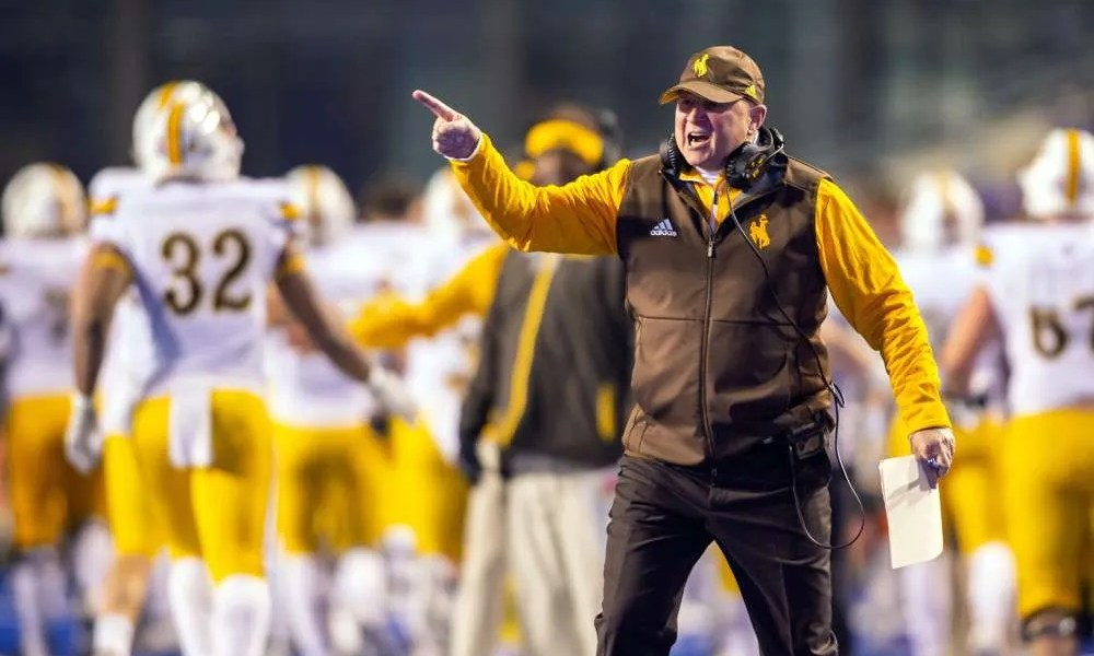 Craig Bohl coaching football at Wyoming
