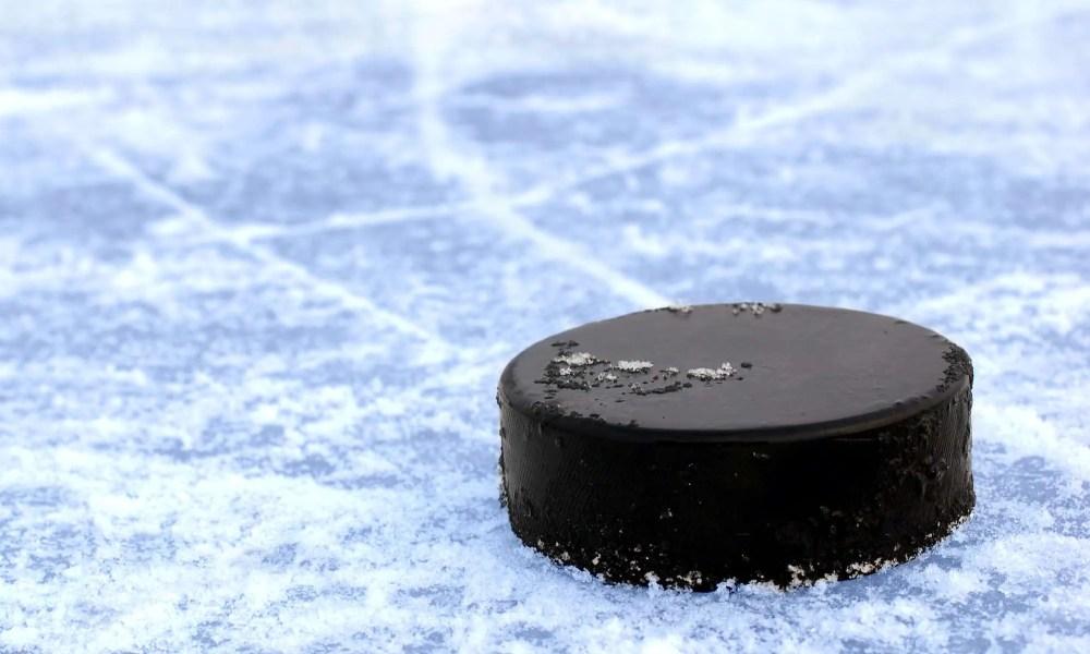 college hockey puck on ice
