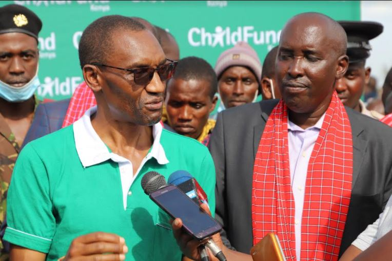 ChildFund Country Director Chege Ngugi (left) and Kajiado County Governor Joseph ole Lenku speak after the launch of the Masimba Milk Processing Plant in Emali, in Kajiado County.