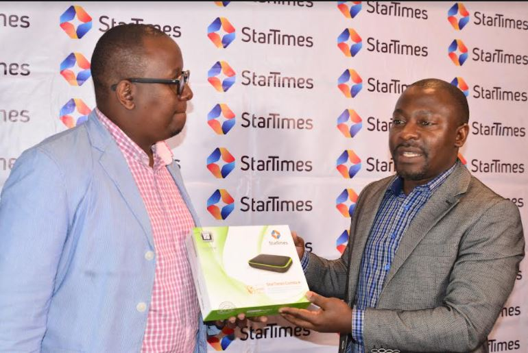 StarTimes Content Director Myke Mwai (left) and the company's Regional Marketing Director Aldrine Nsubuga (right) showcase the company's digital television set top box at a past event.