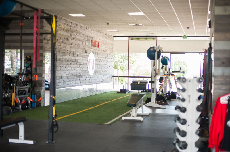 Core Progression. View of the inside of a new gym showing exercise equipment.