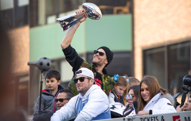 Tom Brady holding the Lombardi Trophy at a Patriots Super Bowl Parade