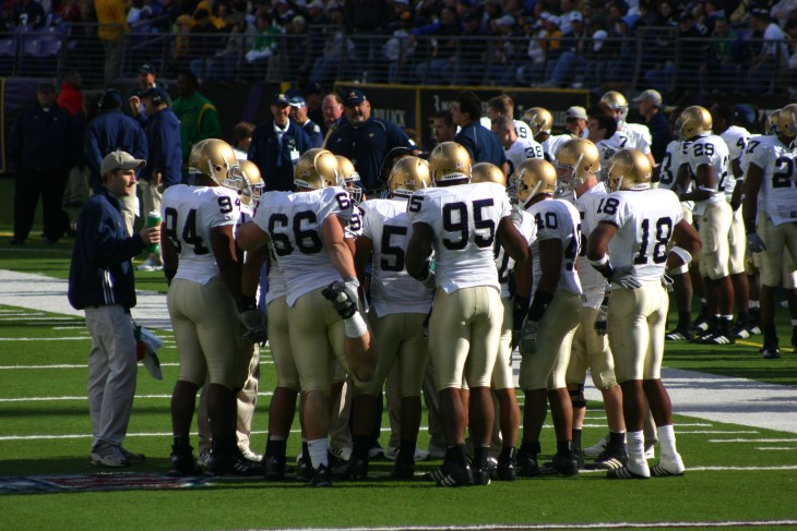 Notre Dame huddles on the sideline for a timeout during the Navy game on October 28, 2006