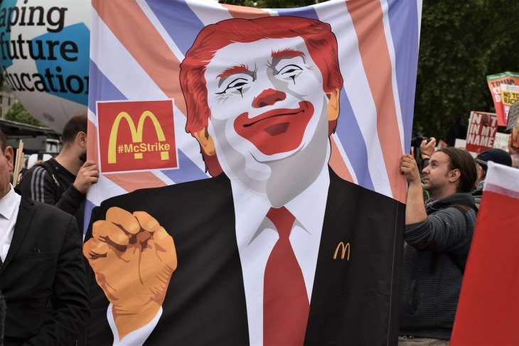London, UK - 04/06/2019 - During the protest one of the signs had Donald Trump on. The American president have had a make up just like the clown of the McDonalds.
