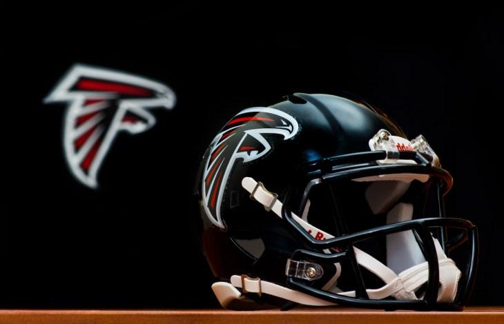 ZAGREB , CROATIA - NOVEMBER 19 , 2014 : NFL Atlanta Falcons equipment , helmet and flag ,product shot