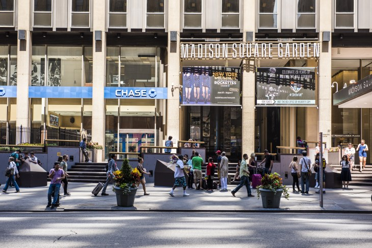 New York, USA - June 18, 2016: People walk near Madison Square Garden and Chase bank in New York City