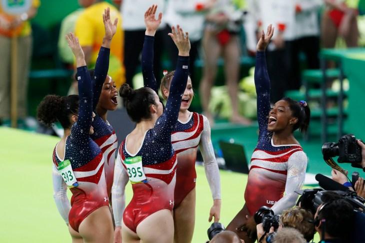 RIO DE JANEIRO, BRAZIL 08/09/2016: Team USA wins gold medal at Rio 2016 Olympic Games, artistic gymnastics. Celebration of Simone Biles, Aly Raisman, Gabby Douglas, Madison Kocian, Laurie Hernandez.
