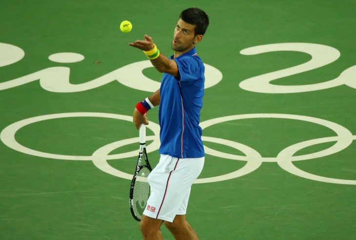 RIO DE JANEIRO, BRAZIL - AUGUST 7, 2016: Grand Slam champion Novak Djokovic of Serbia in action during men's singles first round match of the Rio 2016 Olympic Games at the Olympic Tennis Centre