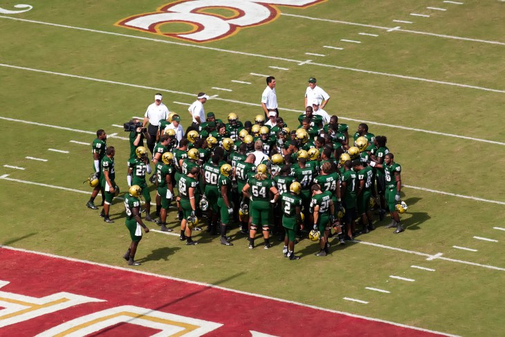 TALLAHASSEE, FL - SEPTEMBER 26: University South Florida gather for coach pep talk before game against Florida State at Doak Campbell Stadium September 26, 2009 in Tallahassee, Florida.