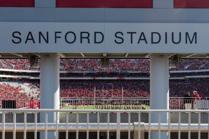 Athens, United States: April 11, 2020: Georgia Logo on Sanford Stadium Fence with empty stadium seats