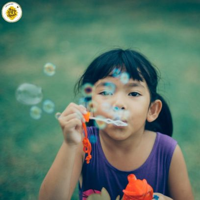 child blowing bubbles - using resources from home