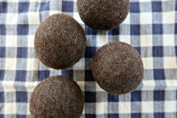 Working towards reducing chemicals in your home? These easy DIY wool dryer balls are an awesome way to reduce chemicals when you do your laundry!
