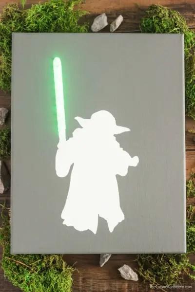 Yoda-Canvas-Art-with-Lighted-Green-Lightsaber-