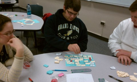 Three students playing the 3-player version of the game.