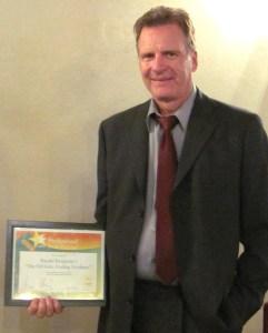 Randal Benjamin receiving the Hollywood Book Festival award.