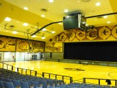 ::auditorium/basketball court of course decorated with corn murals::