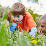 3 children looking at grass-Curiosity in Kids