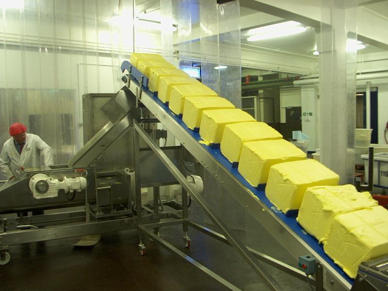 Butter blocks on conveyor of screw feeder