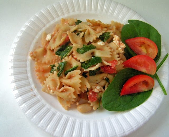 Spinach feta pasta is a great vegetarian dish packed with flavor and protein. With white beans, diced tomatoes, spinach, and feta cheese in every bite, you'll love this perfect summertime meal.