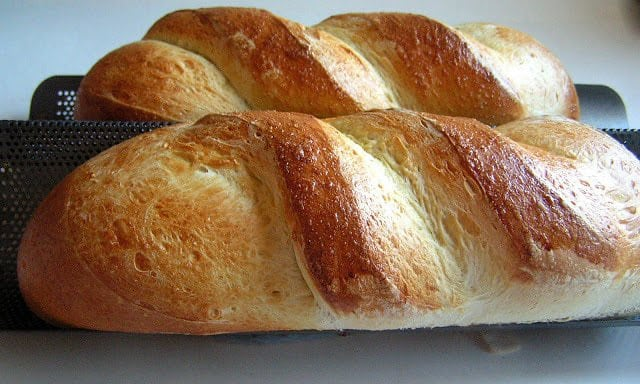 French Bread made with simple ingredients at home! In under 2 hours you'll have 2 large loaves of delicious homemade French Bread. Try it!