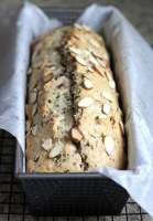 Cherry nut bread is a tasty and sweet treat that rests in that gray area between snack and dessert. It's so delicious it could easily fit into either category. Top with some sliced almond slivers and it's just as beautiful as it is delicious.