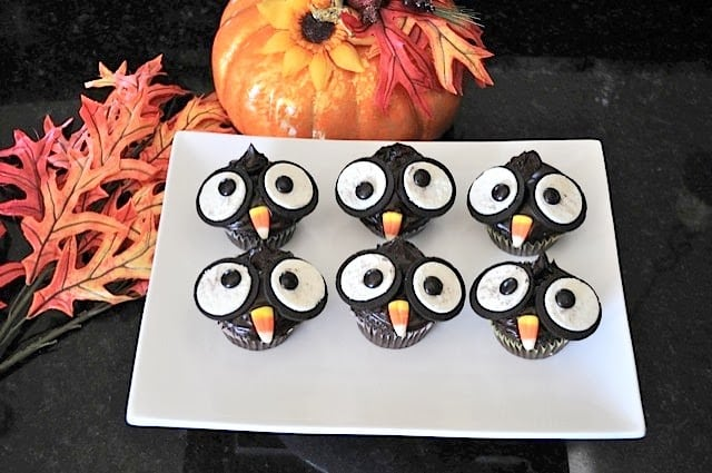 Oreo Owl Cupcakes take regular cupcakes up a notch by making them festive and adorable for the Halloween season - they are a hit at every party!