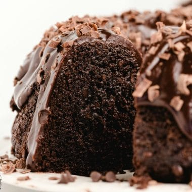 Death by Chocolate Cake is a sinfully delicious cake with 4x the chocolate! Packed with rich chocolatey goodness, this chocolate cake recipe is perfectly moist and sweet. Perfect for chocoholics!
